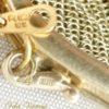plaque-oro-doce-micras-bolsos-de-coleccion-