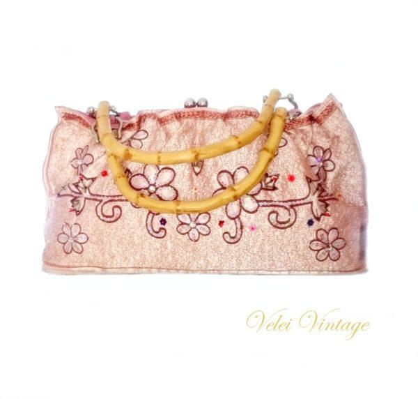 bolso-de-ceremonia-boda-coral-vintage-boquilla-asas-de-bambu